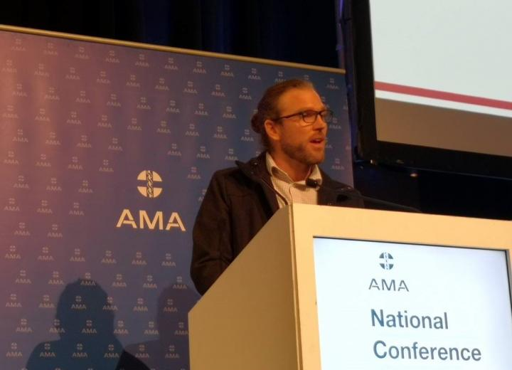 Dr Joshua Francis accepts the Medical Journal of Australia / MDA National Prize for Excellence in Medical Research at the Australian Medical Association National Conference